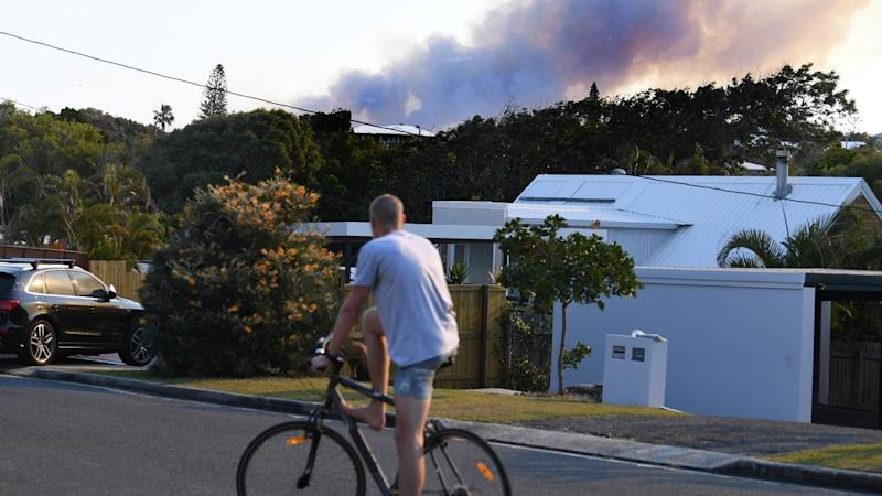A destructive Sunshine Coast fire has been downgraded overnight but unfavourable weather is forecast