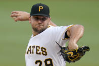 Pittsburgh Pirates starting pitcher Wil Crowe delivers during the first inning of the team's baseball game against the Philadelphia Phillies in Pittsburgh, Friday, July 30, 2021. (AP Photo/Gene J. Puskar)