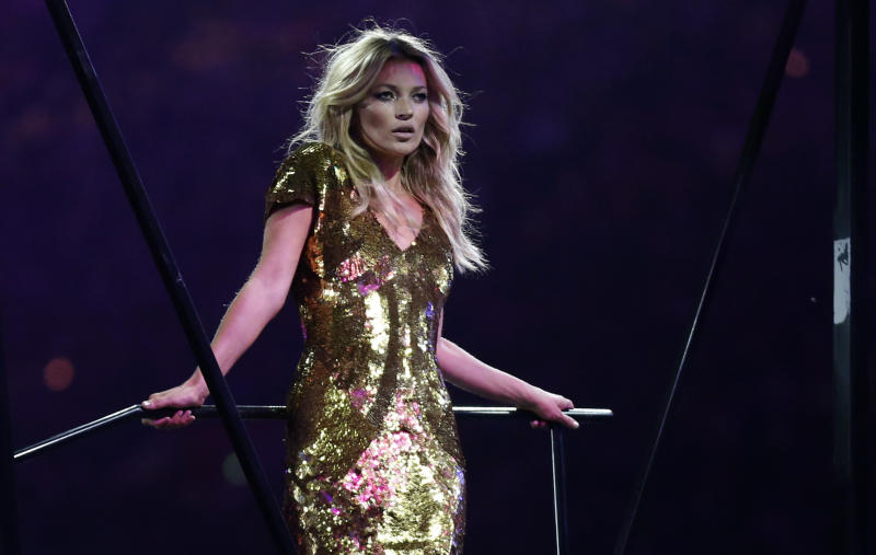 British model Kate Moss poses on stage during the Closing Ceremony at the 2012 Summer Olympics, Sunday, Aug. 12, 2012, in London. (AP Photo/Matt Dunham)