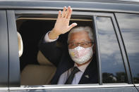 Former Deputy Prime Minister Ismail Sabri Yaakob waves to media as he leave after meeting with the King at national palace in Kuala Lumpur, Malaysia, Thursday, Aug. 19, 2021. Yaakob appeared to have won majority support to be Malaysia's new leader. His backers have been summoned to the palace Thursday to verify to the king they support him. (AP Photo/FL Wong)