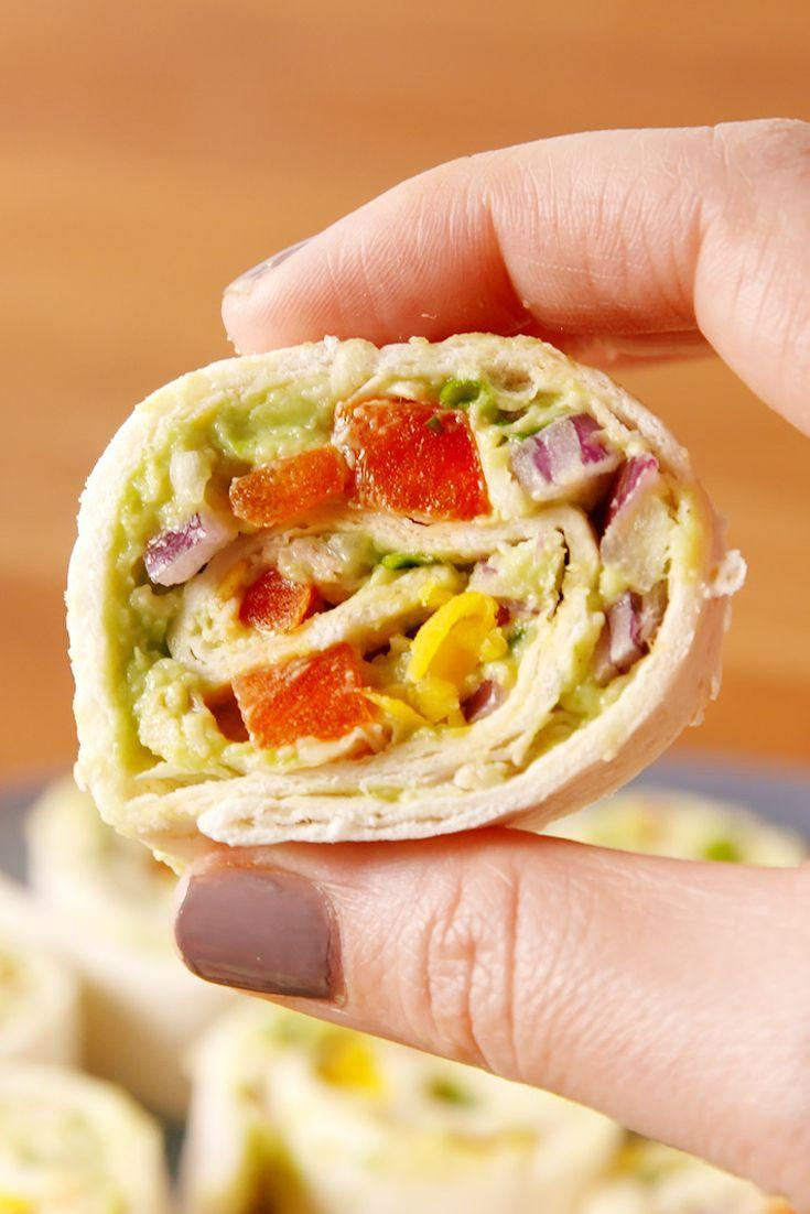 """<p>These chicken avocado salad pinwheels double as a nutritious lunch and an adorable party appetizer.</p><p>Get the recipe from <a href=""""https://www.redbookmag.com/cooking/recipes/a52540/chicken-avocado-roll-ups/"""" rel=""""nofollow noopener"""" target=""""_blank"""" data-ylk=""""slk:Delish"""" class=""""link rapid-noclick-resp"""">Delish</a>.</p>"""