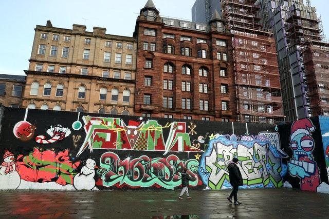 Members of the public view graffiti in Glasgow, Scotland (Andrew Milligan/PA)