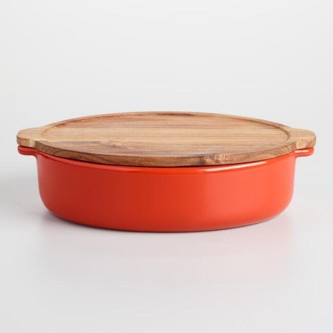 "Add a splash of autumnal color to your table setting with this <a href=""https://www.worldmarket.com/product/large+red+baker+with+oak+wood+trivet+lid.do?sortby=ourPicks&from=Search"" target=""_blank"">large red baker</a>."