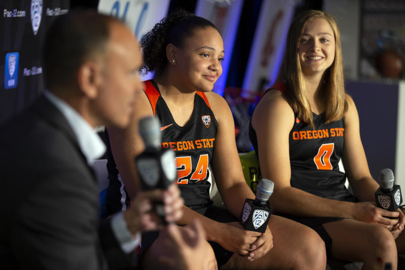 Oregon State head coach Scott Rueck, from left, along with players Destiny Slocum and Mikayla Pivec, speaks to reporters during the Pac-12 Conference Women's NCAA College Basketball Media Day, Monday, Oct. 7, 2019 in San Francisco. (AP Photo/D. Ross Cameron)