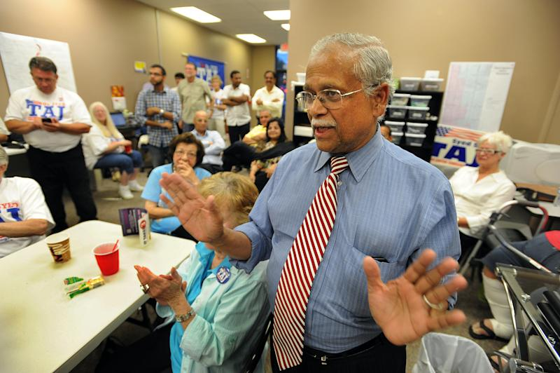 In this Aug. 7, 2012 photo Dr. Syed Taj, a Republican candidate who is running against Democrat Kerry Bentivolio for a seat in Michigan's 11th Congressional District, thanks supporters at a primary election night party in Novi, Mich. The campaign for a U.S. House seat in suburban Detroit remains muddled three months after the incumbent's path toward likely re-election ended with his resignation. Rep. Thaddeus McCotter shockingly quit in July after failing to submit enough valid petition signatures to run. The only Republican left on the ballot was Kerry Bentivolio, a war veteran, reindeer farmer and Santa Claus impersonator. Democrats nominated physician Taj, sensing a rare opportunity to capture a seat in a majority Republican district. As the race enters its final days, the focus has been more on the candidates' personal qualities than the issues. Democrats contend Bentivolio is a right-wing extremist and mentally unfit to serve, while Republicans say Taj is a radical leftist with suspicious foreign ties. (AP Photo/The Detroit News, Bryan Mitchell)
