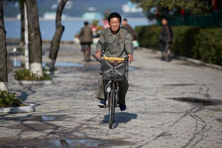 A man cycles near the waterfront in Wonsan, North Korea, October, 2016. Christian Peterson-Clausen/Handout via REUTERS