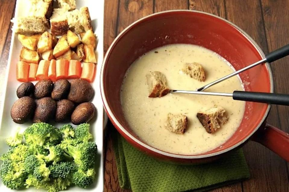 "<p>Hello, dill-flavored cheese! This five-ingredient fondue is easy to make, and oh-so easy to eat. The fun dill flavor gives the recipe a kick, so be sure to make this when you're feeling adventurous. </p> <p><strong>Get the recipe</strong>: <a href=""https://jamiegeller.com/recipes/dill-havarti-fondue/"" class=""link rapid-noclick-resp"" rel=""nofollow noopener"" target=""_blank"" data-ylk=""slk:dill havarti fondue"">dill havarti fondue</a></p>"