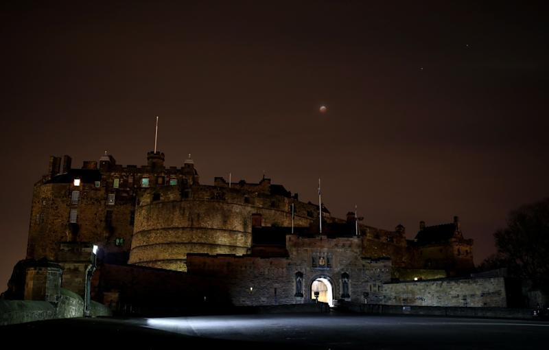 The super blood wolf moon over Edinburgh Castle in Scotland.
