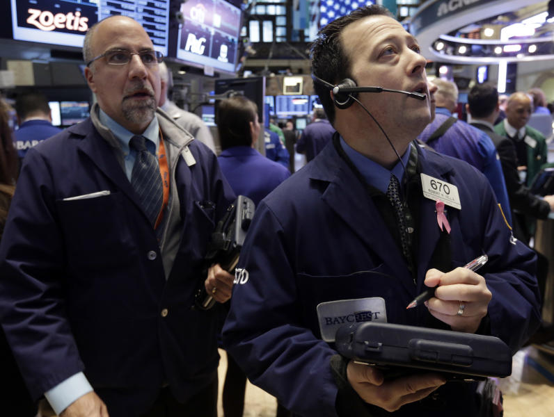 Trader Robert Vella, right, works on the floor of the New York Stock Exchange Tuesday, Feb. 5, 2013. Stocks are turning higher in early trading on Wall Street following a spike in home prices and strong earnings reports from Kellogg and other U.S. companies. (AP Photo/Richard Drew)