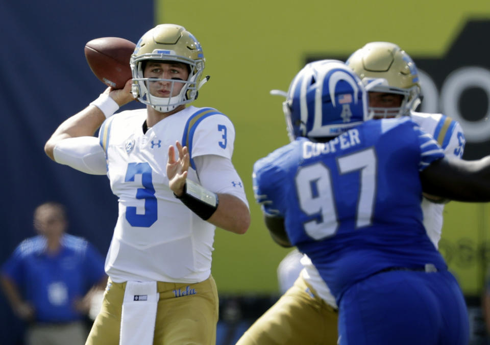 UCLA quarterback Josh Rosen (3) passes in the first half of an NCAA college football game Saturday, Sept. 16, 2017, in Memphis, Tenn. (AP Photo/Mark Humphrey)