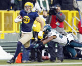Philadelphia Eagles' Bradley Fletcher trips up Green Bay Packers' Jordy Nelson after a 64-yard pass reception during the first half of an NFL football game Sunday, Nov. 16, 2014, in Green Bay, Wis. (AP Photo/Mike Roemer)