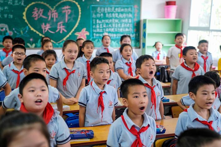 Elementary school students attend a class on the first day of the new semester in Wuhan in China's central Hubei province on September 1, 2020.