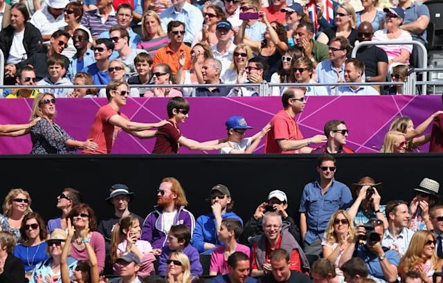 LONDON, ENGLAND - JULY 30: The crowd dance a Conga on Day 3 of the London 2012 Olympic Games at Horse Guards Parade on July 30, 2012 in London, England. (Photo by Ryan Pierse/Getty Images)