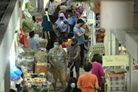Shoppers in the Geylang Serai market in Singapore