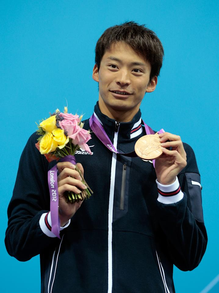 LONDON, ENGLAND - JULY 30:  Bronze medalist Ryosuke Irie of Japan celebrates with his medal during the medal ceremony for the Men's 100m Backstroke on Day 3 of the London 2012 Olympic Games at the Aquatics Centre on July 30, 2012 in London, England.  (Photo by Adam Pretty/Getty Images)