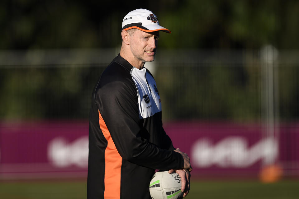 Seen here, Wests Tigers coach Michael Maguire looks on during a training session with the NRL club.