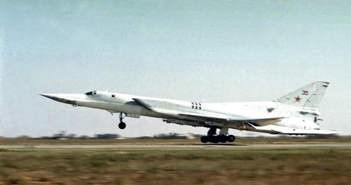FILE - In this June, 2001 file photo, A Tu-22M3 bomber of the Russian air force takes off somewhere at undisclosed location in Russia. The Russian military says that three members of a Russian warplane crew have died when their ejection seats accidentally activated during preflight checks on Tuesday, March 23, 2021 at a military airbase in the Kaluga region, about 145 kilometers (90 miles) southwest of Moscow. It said the crew of a Tu-22M3 long-range bomber was preparing for a training mission when its rescue system malfunctioned and accidentally bailed the crew out. (AP Photo, File)