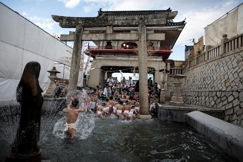 Japanese boys step out of a fountain after being purified during the boys' event in the annual Naked Man Festival or 'Hadaka Matsuri'at Saidaiji Temple in Okayama, western Japan (AFP Photo/Behrouz MEHRI)