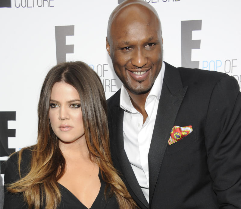 "FILE - In this April 30, 2012 file photo, Khloe Kardashian Odom and Lamar Odom from the show ""Keeping Up With The Kardashians"" attend an E! Network upfront event at Gotham Hall in New York. After months of speculation, Kardashian is ending her four-year marriage to Odom. The Reality TV star filed for divorce Friday, Dec. 13, 2013, in Los Angeles County Superior Court, citing irreconcilable differences. (AP Photo/Evan Agostini, File)"