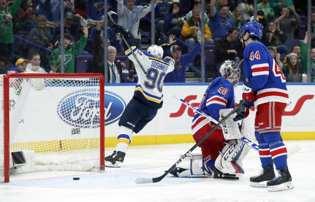 St. Louis Blues' Nikita Soshnikov (90), of Russia, celebrates after scoring past New York Rangers goaltender Alexandar Georgiev, of Bulgaria, and Neal Pionk (44) during the second period of an NHL hockey game Saturday, March 17, 2018, in St. Louis. (AP Photo/Jeff Roberson)