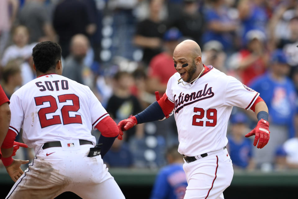 Washington Nationals' Yadiel Hernandez (29) celebrates his walkoff home run with teammate Juan Soto (22) as he heads toward home during the ninth inning of a baseball game against the Chicago Cubs, Sunday, Aug. 1, 2021, in Washington. (AP Photo/Nick Wass)