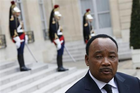 Niger's President Issoufou talks to journalists after a meeting with French President at the Elysee Palace in Paris