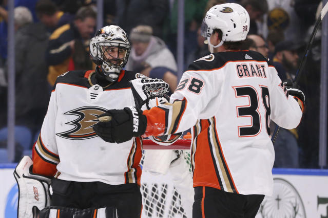 Anaheim Ducks goalie Ryan Miller (30) and forward Derek Grant (38) celebrate a 3-2 victory over the Buffalo Sabres following the third period of an NHL hockey game Sunday, Feb. 9, 2020, in Buffalo, N.Y. (AP Photo/Jeffrey T. Barnes)
