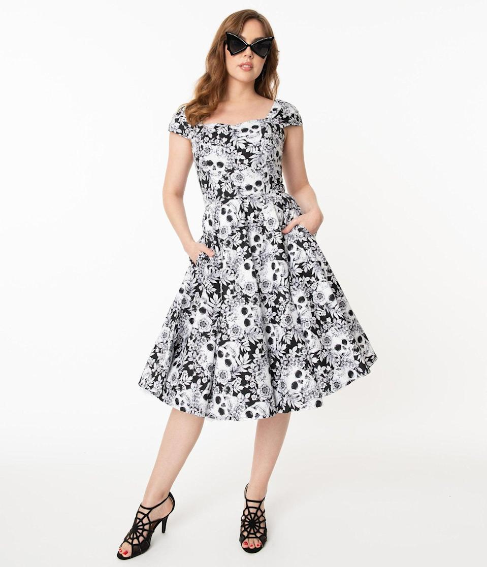 <p>Dress your best in this <span>Black and White Skulls and Roses Print Aida Swing Dress</span> ($88). </p>