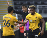 Wolverhampton Wanderers' Hwang Hee-chan walks off after being substituted by Wolverhampton Wanderers' Adama Traore, right, during the English Premier League soccer match between Wolverhampton Wanderers and Newcastle United at Molineux stadium in Wolverhampton, England, Saturday, Oct. 2, 2021. (AP Photo/Rui Vieira)