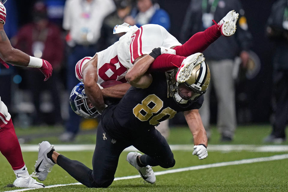 New York Giants C.J. Board is upended by New Orleans Saints Chris Hogan (80) on a return in the first half of an NFL football game in New Orleans, Sunday, Oct. 3, 2021. (AP Photo/Brett Duke)