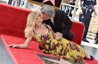 """<p>This body language is one giant sign pointing to endearing love, says Donaldson. """"The way in which Kurt holds Goldie's hands in both of his as he kisses her, shows a truly deep connection on an emotional and physical level,"""" she emphasizes. </p><p>This nonverbal cue, is a tender one that speaks to a high level of <a href=""""https://www.womenshealthmag.com/sex-and-love/a32007484/intimate-relationship/"""" rel=""""nofollow noopener"""" target=""""_blank"""" data-ylk=""""slk:intimacy"""" class=""""link rapid-noclick-resp"""">intimacy</a> and the importance of physical touch in this couple's relationship. </p>"""