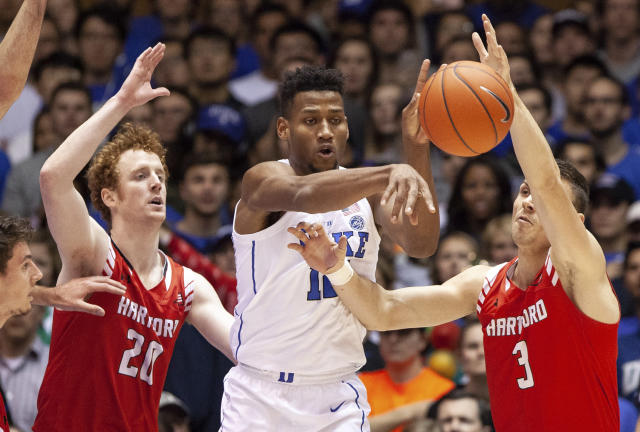 Duke's Javin DeLaurier, middle, passes away from the defense of Hartford's Max Twyman (20) and Romain Boxus (3) during the first half of an NCAA college basketball game in Durham, N.C., Wednesday, Dec. 5, 2018. (AP Photo/Ben McKeown)