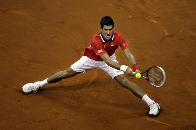 Serbia's Novak Djokovic returns the ball to Canada's Milos Raonic during their Davis Cup semifinals tennis match in Belgrade, Serbia, Sunday, Sept. 15, 2013. (AP Photo/ Marko Drobnjakovic)