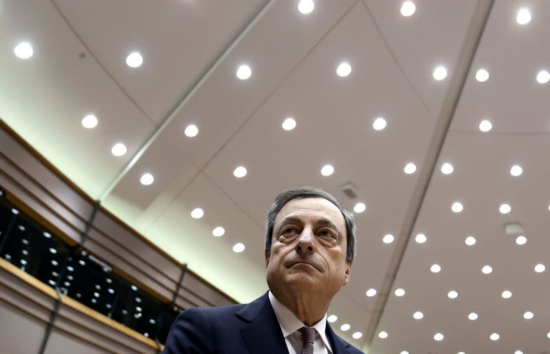 ECB President Draghi arrives to take part in a plenary debate on the ECB's Annual Report 2013 at the EU Parliament in Brussels