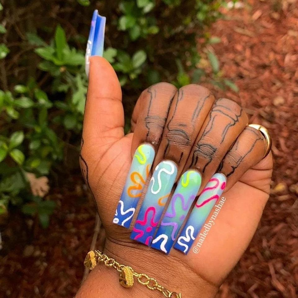 <em>Spongebob Squarepants</em> fans will surely recognize these multicolored florals, which make up the clouds in Bikini Bottom. Nashae certainly excelled at creating each flower in pretty hues. We love that she designed them on top of a blue ombré base.