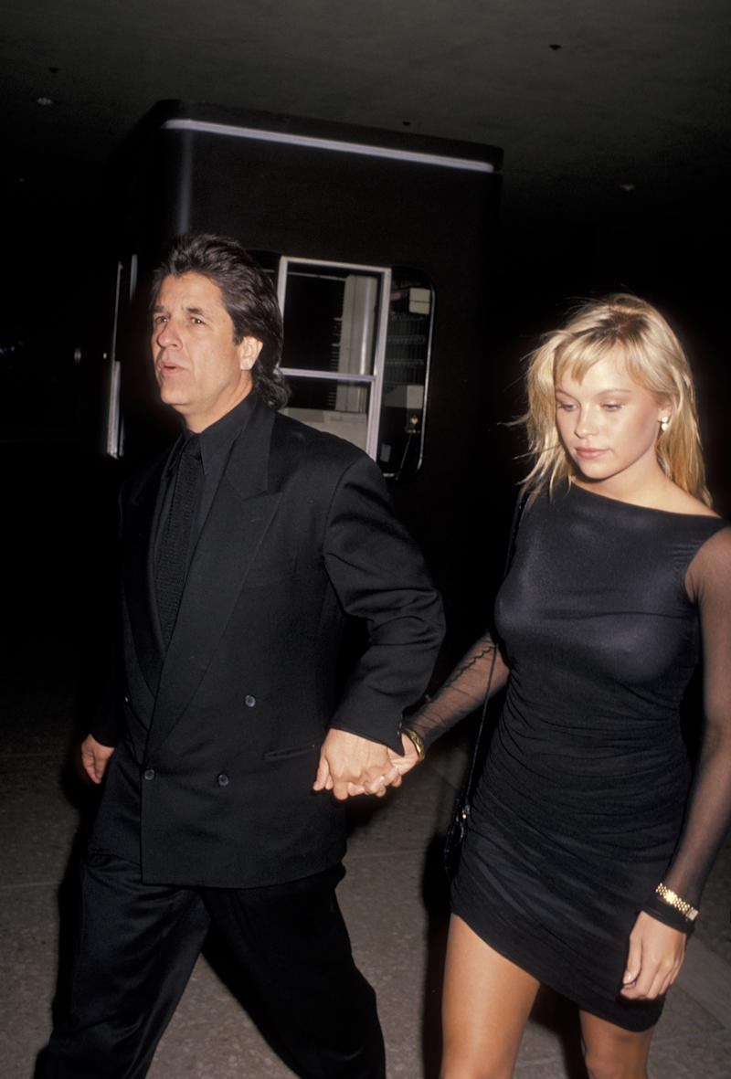 Producer Jon Peters and model Pamela Anderson attend the premiere of 'Glory' on December 11, 1989 at the Cineplex Odeon Cinema in Century City, California. (Photo by Ron Galella, Ltd./Ron Galella Collection via Getty Images)