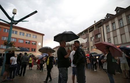 People take part in a protest against migrants in the Bosnian town of Bihac