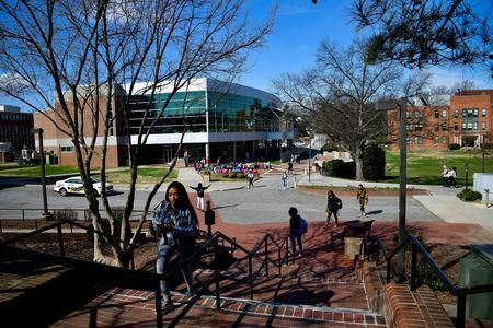 Students walk between classes at North Carolina A&T University just to the west of the line that divides Congressional Districts 13 and 6 on campus in Greensboro, North Carolina, U.S. March 14, 2019.   REUTERS/Charles Mostoller