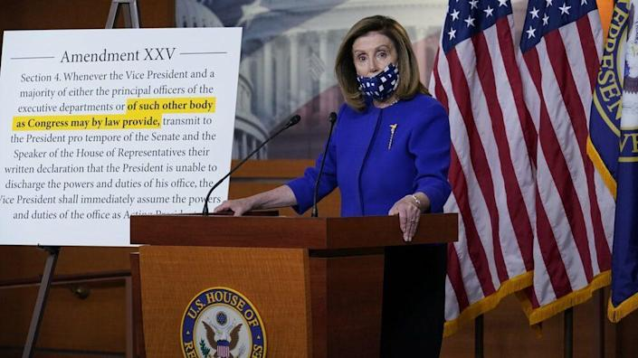 Speaker of the House Nancy Pelosi, D-Calif., questions President Donald Trump's fitness to serve following his hospitalization for COVID-19, during a news conference at the Capitol in Washington, Friday, Oct. 9, 2020. (AP Photo/J. Scott Applewhite)