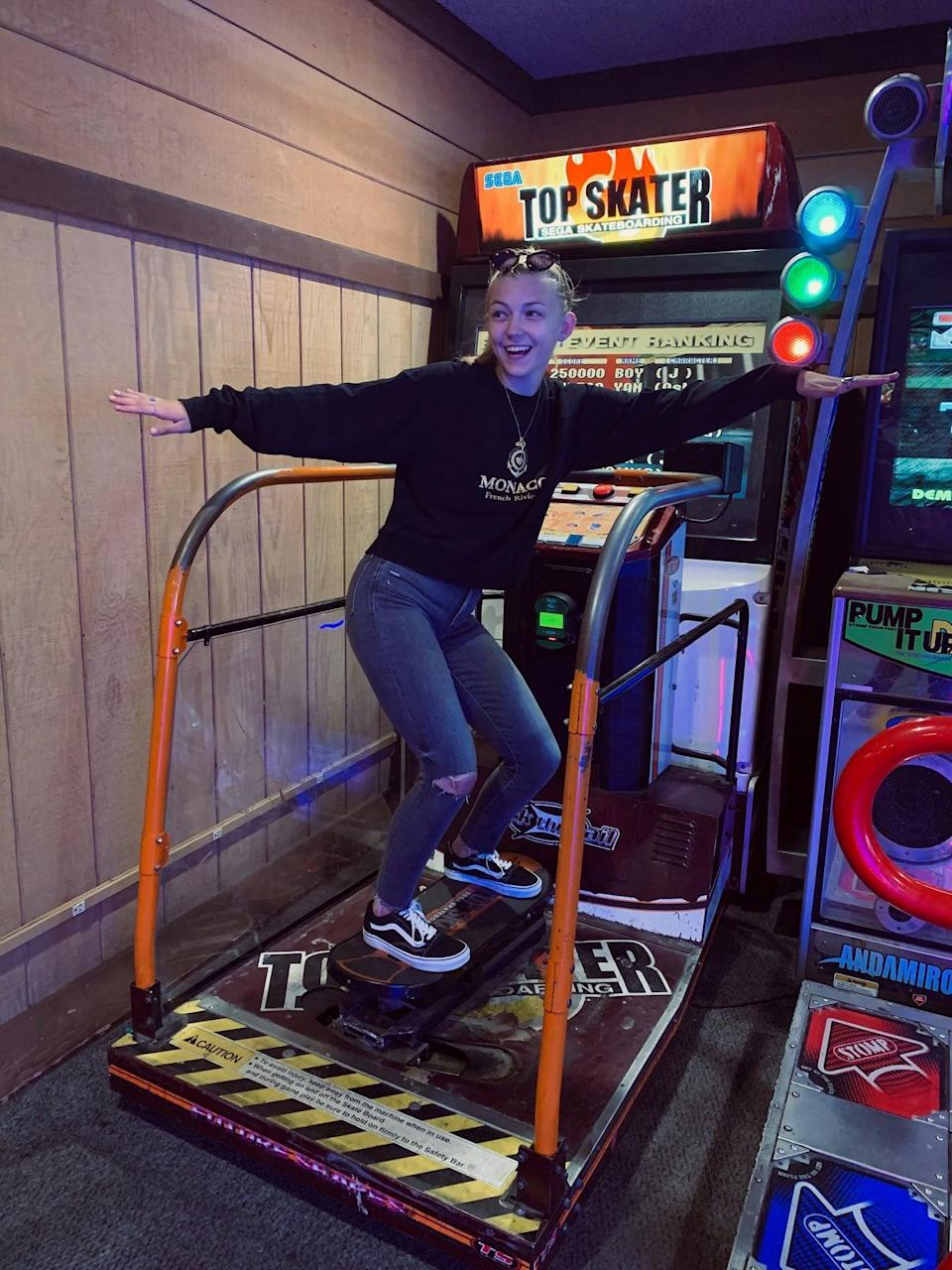 Gabby Petito plays a skateboarding video game at an arcade. (Find Gabby Facebook page)