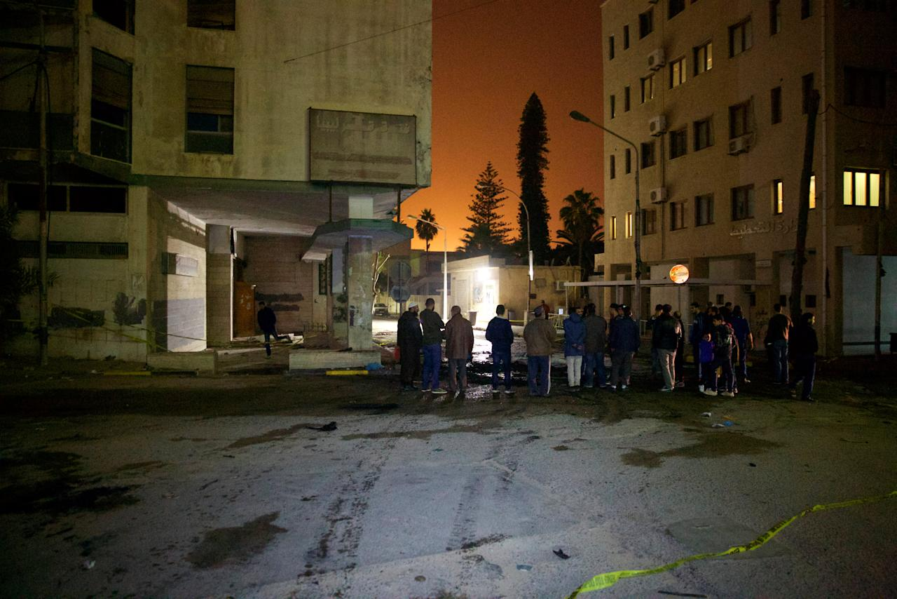 People gather at the scene where a car bomb exploded late on Saturday close to the recently re-opened Italian embassy in Tripoli, Libya January 21, 2017. Picture taken January 21, 2017. REUTERS/Stringer EDITORIAL USE ONLY. NO RESALES. NO ARCHIVE.