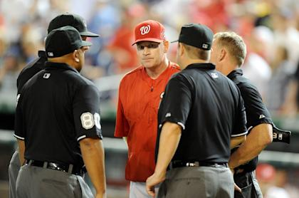 Washington manager Matt Williams talks with the umpire crew during a game at Nationals Park. (Getty)