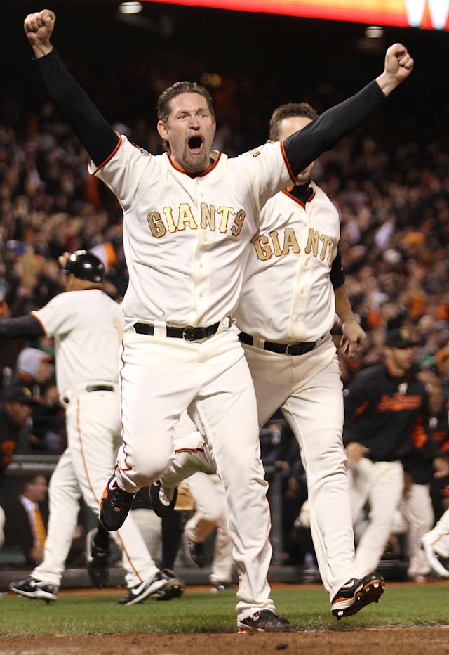 SAN FRANCISCO, CA - APRIL 09: Aubrey Huff #17 celebrates after Miguel Tejada of the San Francisco Giants hit the game winning hit in the ninth inning against the St. Louis Cardinals at AT&T Park on April 9, 2011 in San Francisco, California. (Photo by Jed Jacobsohn/Getty Images)