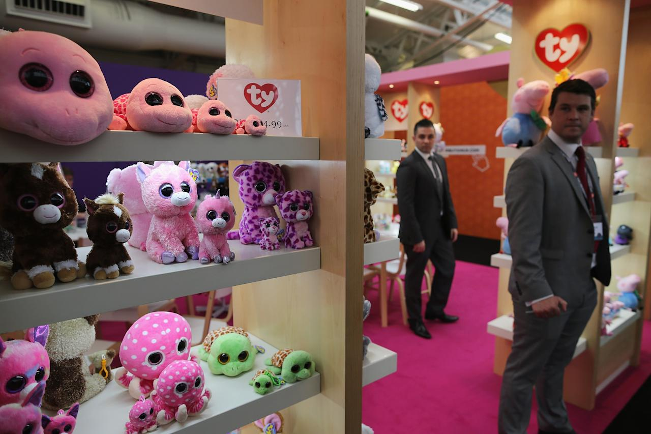 LONDON, ENGLAND - JANUARY 22: People work on a trade stand during the 2013 London Toy Fair at Olympia Exhibition Centre on January 22, 2013 in London, England. The annual fair which is organised by the British Toy and Hobby Association, brings together toy manufacturers and retailers from around the world.  (Photo by Dan Kitwood/Getty Images)