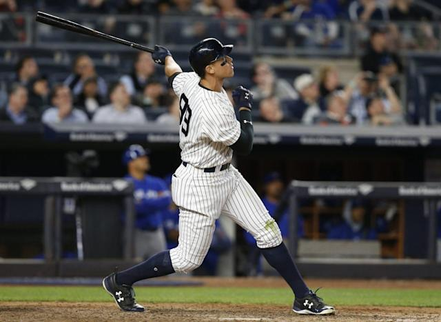 "<a class=""link rapid-noclick-resp"" href=""/mlb/teams/nyy/"" data-ylk=""slk:New York Yankees"">New York Yankees</a> young slugger Aaron Judge can't stop hitting home runs. (AP Photo/Kathy Willens)"