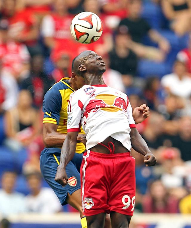 New York Red Bulls forward Bradley Wright-Phillips (99) heads the ball against Arsenal during the first half of an international friendly soccer game on Saturday, June 26, 2014, in Harrison, N.J. (AP Photo/Adam Hunger)