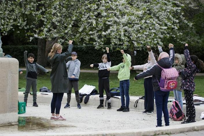 School's back in -- but outside -- Teacher Marie Kaas-Larsen and her pupils warm up for outdoor lessons in a park near their Copenhagen school (AFP Photo/Thibault Savary)