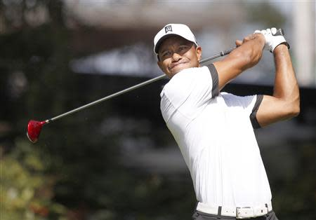 Tiger Woods drives off the fourth tee during the Tour Championship golf tournament in Atlanta