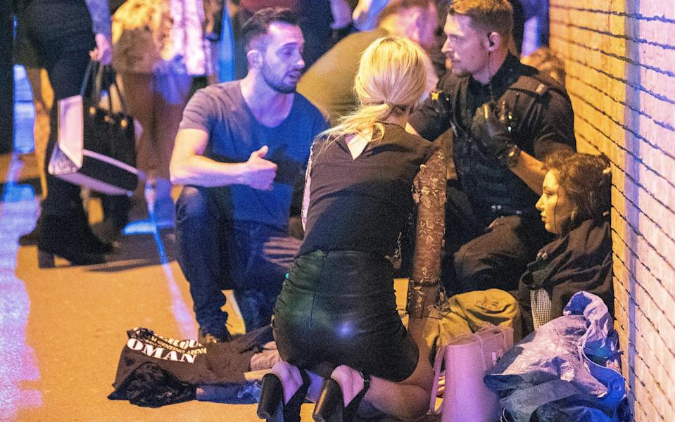 Victims of the Manchester attack are tended to outside the arena - Credit: Joel Goodman/L