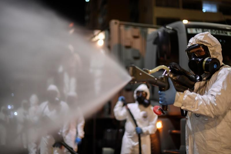 Soldiers from the 4th Military Region of the Brazilian Armed Forces are seen cleaning the outside as they take part in the cleaning and disinfection of the Municipal Market in the Belo Horizonte, state of Minas Gerais, Brazil on August 18, 2020, amid the COVID-19 coronavirus pandemic. (Photo by DOUGLAS MAGNO / AFP) (Photo by DOUGLAS MAGNO/AFP via Getty Images)